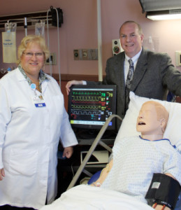Michele and Joe in sim lab training classroom.