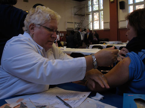 Michele giving a flu shot at St. Mary's Church, in Long Beach, on Long Island, NY.