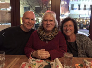 Joe, Michele, and Christine celebrating another great year together!